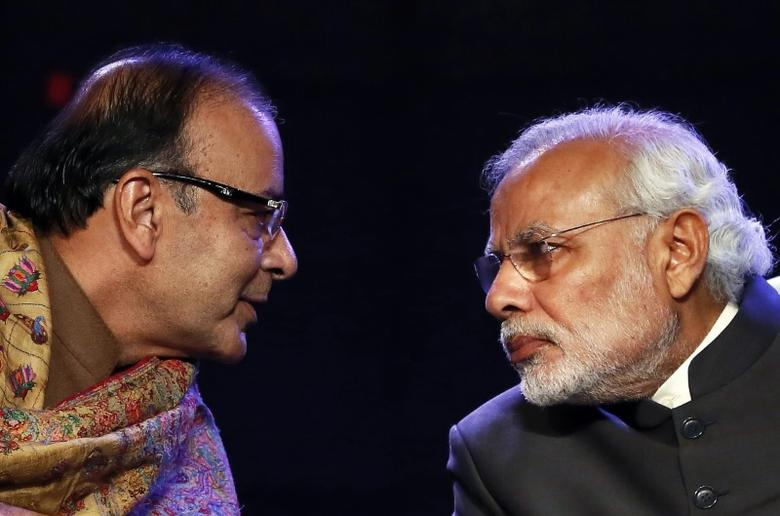 FILE PHOTO: Indian Prime Minister Narendra Modi (R) listens to Finance Minister Arun Jaitley during the Global Business Summit in New Delhi January 16, 2015. REUTERS/Anindito Mukherjee