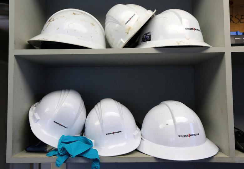 Helmets line a shelf in a control room at Kinder Morgan's Westridge Terminal on Burrard Inlet in Burnaby, British Columbia, Canada November 17, 2017. REUTERS/Chris Helgren