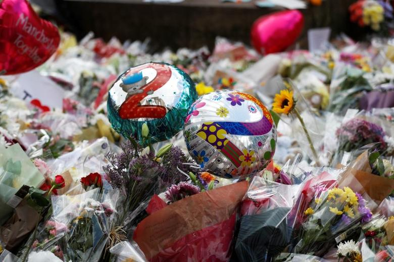 Balloons and floral tributes for the victims of the attack on the Manchester Arena are seen in St Ann's square in Manchester, Britain, May 24, 2017. REUTERS/Peter Nicholls