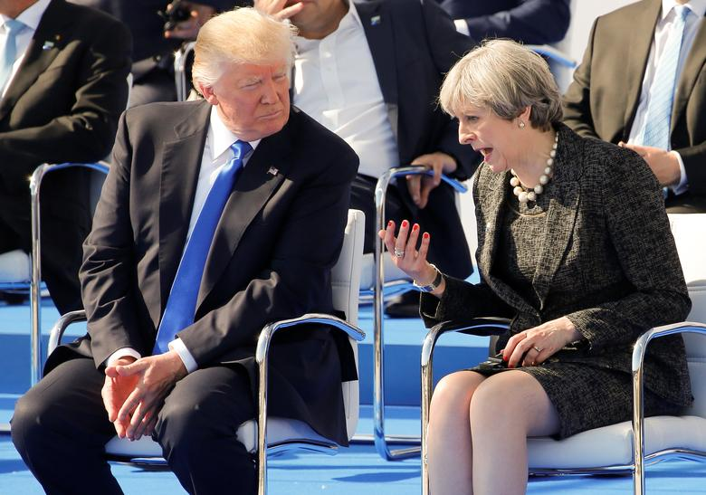 Britain's Prime Minister Theresa May talks to U.S. President Donald Trump as they attend a ceremony at the start of the NATO summit at their new headquarters in Brussels, Belgium, May 25, 2017. REUTERS/Jonathan Ernst