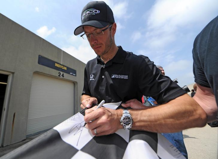May 20, 2017; Indianapolis, IN, USA; IndyCar driver Sebastien Bourdais signs an autograph before qualifying for the 101st Running of the Indianapolis 500 at Indianapolis Motor Speedway. Mandatory Credit: Thomas J. Russo-USA TODAY Sports