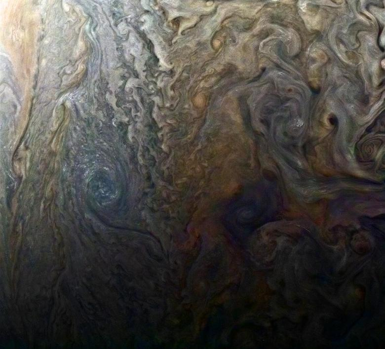 NASA's enhanced-color image of a mysterious dark spot on Jupiter shows a Jovian ''galaxy'' of swirling storms in this image captured by NASA's Juno spacecraft on February 2, 2017, at 5:13 a.m. PDT (8:13 a.m. EDT), at an altitude of 9,000 miles (14,500 kilometers) above Jupiter's cloud tops.  Roman Tkachenko/Courtesy NASA/JPL-Caltech/SwRI/MSSS/Handout via REUTERS