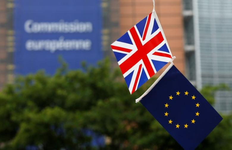 FILE PHOTO: A British Union flag and an European Union flag are seen flying outside the European Commission headquarters in Brussels, Belgium, June 1, 2016. REUTERS/Francois Lenoir