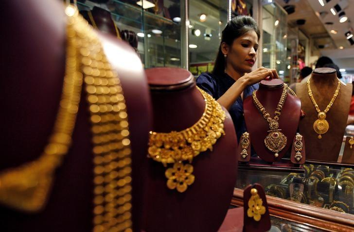 A salesperson attends to a customer (not pictured) inside a jewellery showroom, during Akshaya Tritiya, a major gold-buying festival, in Mumbai, India April 28, 2017. REUTERS/Shailesh Andrade
