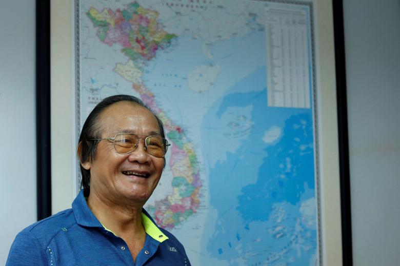 Former head of the National Boundary Commission of Vietnam Tran Cong Truc poses for a photo in front of Vietnam map during an interview with Reuters in Hanoi, Vietnam May 16, 2017.  REUTERS/Kham