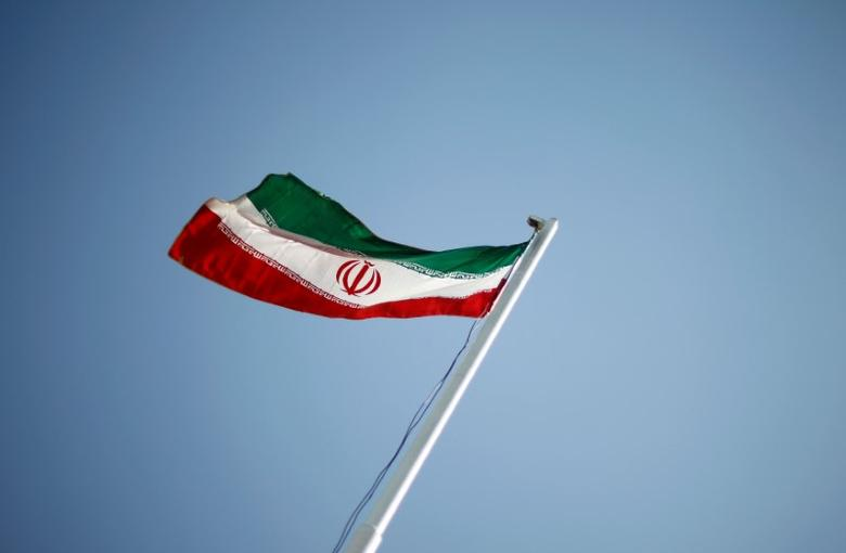FILE PHOTO: An Iranian national flag flutters during the opening ceremony of the 16th International Oil, Gas & Petrochemical Exhibition (IOGPE) in Tehran April 15, 2011. REUTERS/STR/File Photo