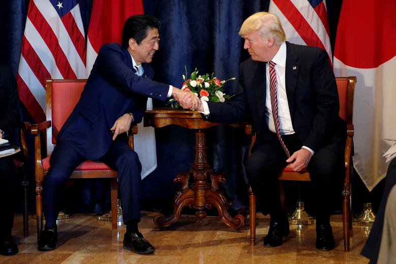 U.S. President Donald Trump (R) and Japan's Prime Minister Shinzo Abe shake hands during a bilateral meeting at the G7 summit in Taormina, Sicily, Italy, May 26, 2017.   REUTERS/Jonathan Ernst