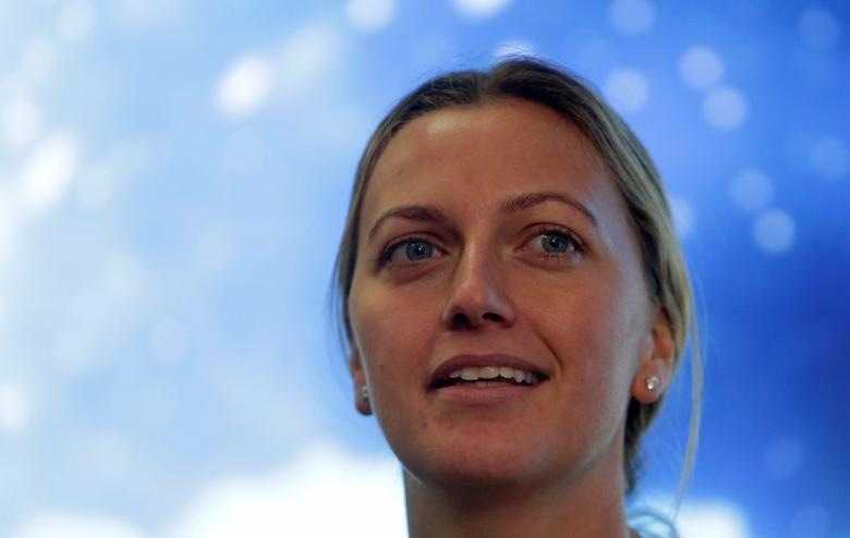 FILE PHOTO - Czech Republic's tennis player Petra Kvitova speaks during a news conference, after she was injured on Tuesday when she fought off an intruder in her home, damaging all the fingers on her playing hand, in Prague, Czech Republic December 23, 2016.    REUTERS/David W Cerny