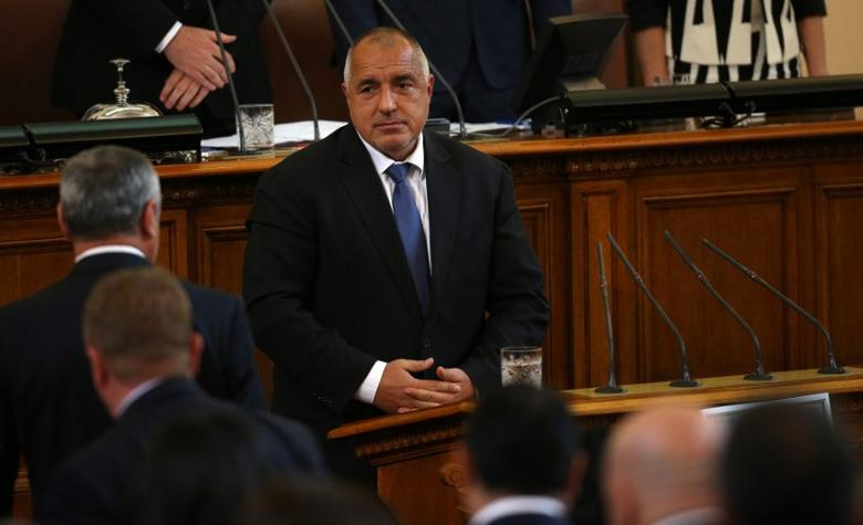 Bulgaria's new Prime Minister Boiko Borisov looks at members of his cabinet before taking an oath during a swearing-in ceremony in the parliament in Sofia, Bulgaria May 4, 2017. REUTERS/Stoyan Nenov