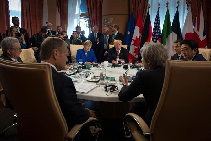 German Chancellor Angela Merkel, U.S. President Donald Trump and other leaders at the G7 summit in Taormina, Sicily, Italy, May 26, 2017. Guido Bergmann/Courtesy of Bundesregierung/Handout via REUTERS