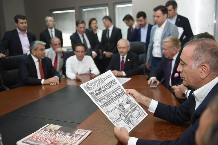Gursel Tekin, a lawmaker from the main opposition Republican People's Party (CHP) holds a print copy of Sozcu daily newspaper as they visit the publication's headquarters in Istanbul, Turkey, May 19, 2017. REUTERS/Ziya Koseoglu