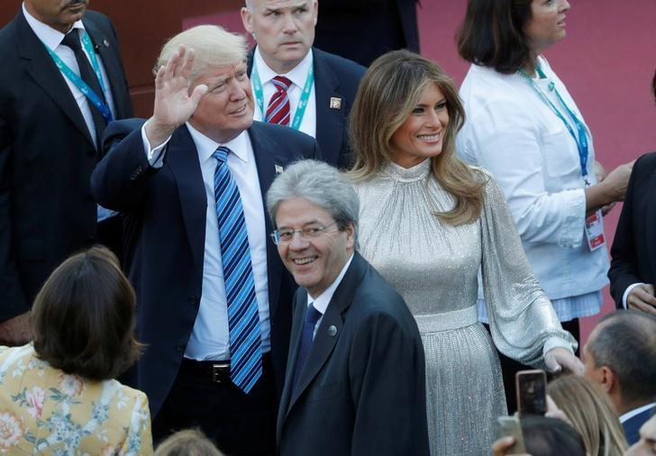 U.S President Donald Trump (L) and first lady Melania Trump arrive with Italian Prime Minister Paolo Gentiloni (C) to attend a performance by the La Scala Philharmonic Orchestra in the ancient Greek theatre as part of the G7 Summit in Taormina, Sicily, Italy, May 26, 2017.       REUTERS/Philippe Wojazer