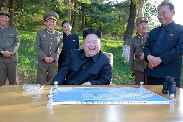 FILE PHOTO : North Korean leader Kim Jong Un inspects the intermediate-range ballistic missile Pukguksong-2's launch test with Ri Pyong Chol (R) in this undated photo released by North Korea's Korean Central News Agency (KCNA) May 22, 2017. REUTERS/KCNA/File Photo
