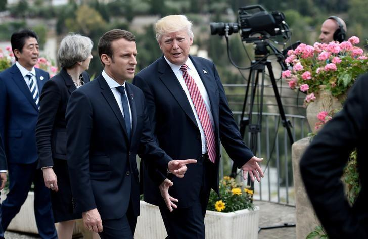 U.S. President Donald Trump (R) talks with French President Emmanuel Macron as they attend the G7 Summit in Taormina, Sicily, Italy, May 26, 2017.   REUTERS/Stephane De Sakutin/Pool