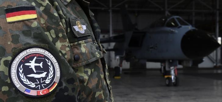 FILE PHOTO - A soldier of the German Armed Forces Bundeswehr wears a patch of the combat wing (Einsatzgeschwader) Counter DAESH Incirlik next to a German Tornado jet in a hangar at the air base in Incirlik, Turkey, January 21, 2016. REUTERS/Tobias Schwarz/Pool