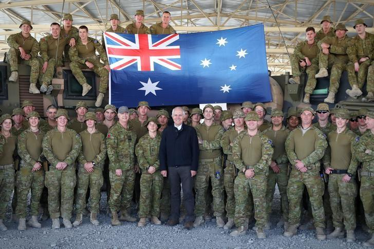 FILE PHOTO: Australia's Prime Minister Malcolm Turnbull poses for a photograph with Australian troops serving at Camp Qargha, located on the outskirts of Kabul in Afghanistan, April 24, 2017. Picture taken April 24, 2017.    AAP/Andrew Meares/via REUTERS/Files
