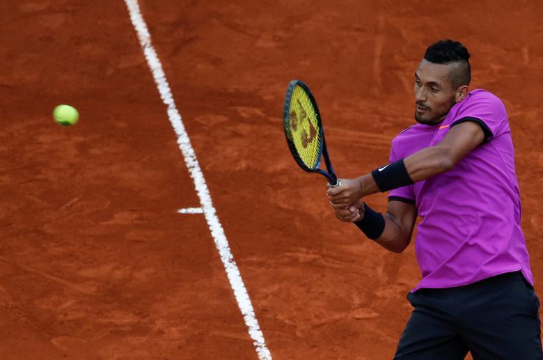 Tennis - ATP 1000 Masters - Madrid Open - Rafael Nadal of Spain v Nick Kyrgios of Australia - Madrid, Spain - 11/5/17- Kyrgios returns a backhand. REUTERS/Sergio Perez