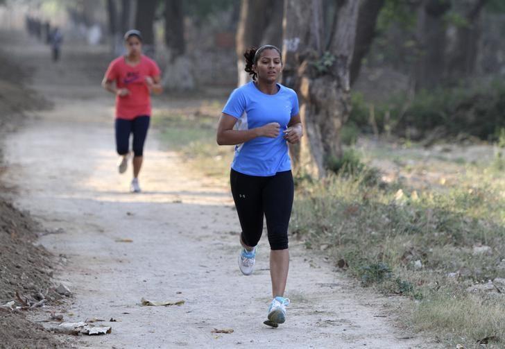 Wrestler Geeta Phogat jogs during a practice session in Patiala, Punjab May 5, 2012. REUTERS/Ajay Verma/Files
