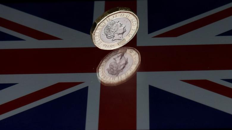 FILE PHOTO: A one pound coin lies on a Union Flag in this picture illustration shot on May 3, 2017. REUTERS/Darren Staples/Illustration/File Photo