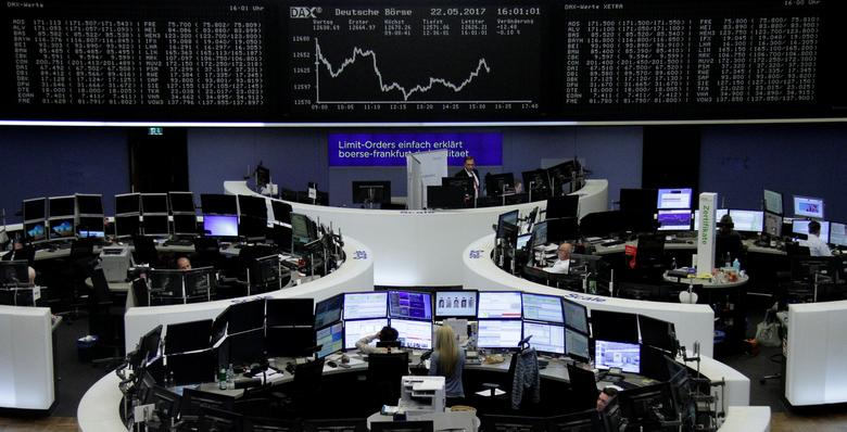 Traders work in front of the German share price index, DAX board, at the stock exchange in Frankfurt, Germany, May 22, 2017. REUTERS/Staff/Remote