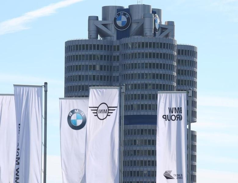 Flags flutter near the headquarters of German luxury carmaker BMW before the company's annual shareholder meeting in Munich, Germany, May 11, 2017. REUTERS/Michael Dalder - RTS165CZ