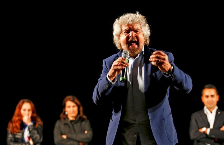 Beppe Grillo, the founder of the anti-establishment 5-Star Movement, talks during a march in support of the 'No' vote in the upcoming constitutional reform referendum in Rome, Italy November 26, 2016. REUTERS/Remo Casilli/File Photo