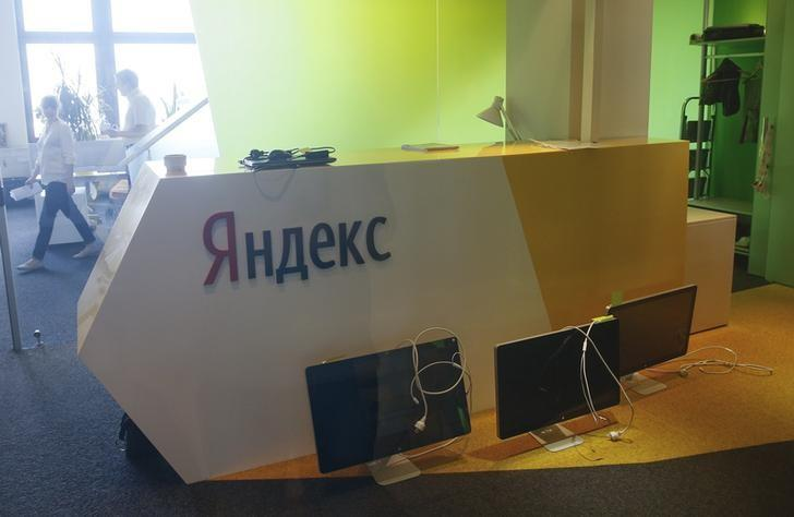 Unplugged computer monitors are seen through a glass door in the office of the Russian internet group Yandex in Kiev, Ukraine, May 29, 2017. REUTERS/Valentyn Ogirenko