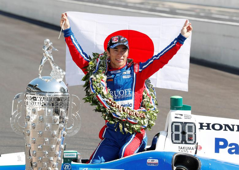 Verizon IndyCar Series driver Takuma Sato poses with a Japanese flag a day after winning the 101st Running of the Indianapolis 500 (Indy 500) at the Indianapolis Motor Speedway in Indianapolis, Indiana, U.S. May 29, 2017. Mandatory Credit: Brian Spurlock-USA TODAY Sports