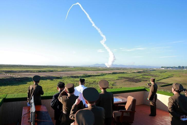 FILE PHOTO: North Korean leader Kim Jong Un watches the test of a new-type anti-aircraft guided weapon system organised by the Academy of National Defence Science in this undated photo released by North Korea's Korean Central News Agency (KCNA) May 28, 2017. KCNA/via REUTERS