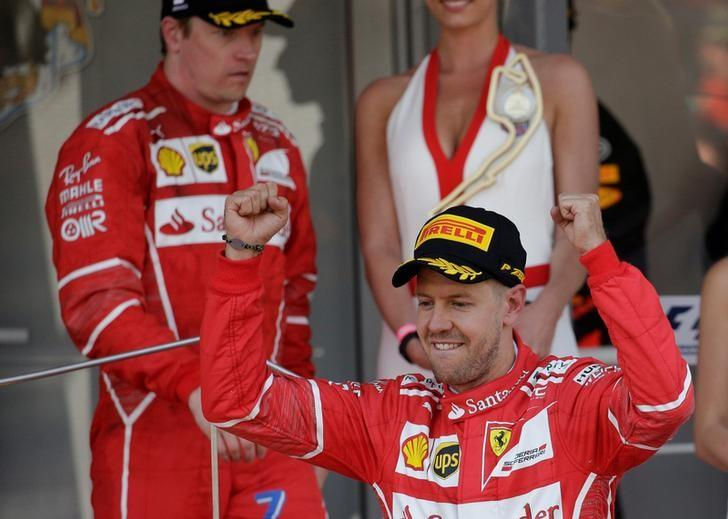 Formula One - F1 - Monaco Grand Prix 2017  - Circuit de Monaco, Monte Carlo  - 28/5/17Ferrari's Sebastian Vettel celebrates winning the race on the podium as Kimi Raikkonen looks dejectedReuters / Max Rossi