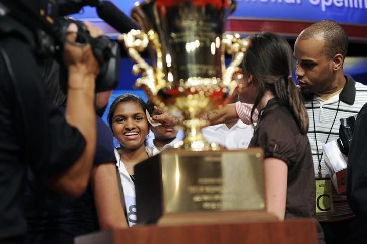 FILE PHOTO: Anamika Veeramani (L) of New Royalton, Ohio, has her brow wiped by a makeup artist during a commercial break as she celebrates after winning the 2010 National Spelling Bee in Washington, June 4, 2010.  REUTERS/Jonathan Ernst/Files