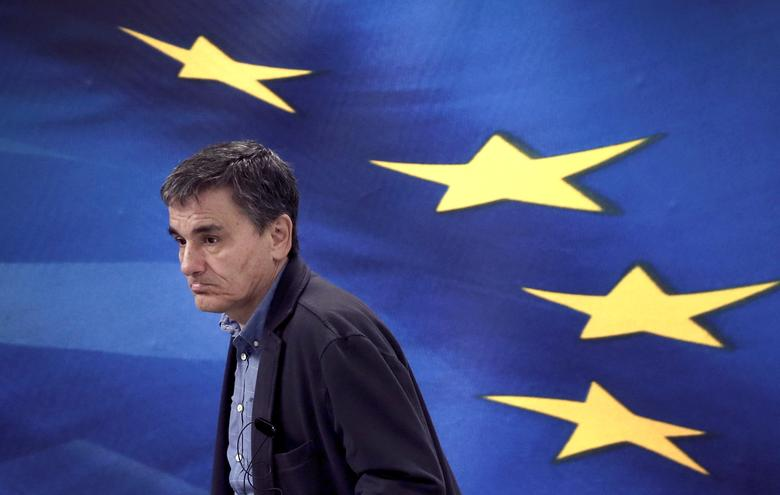 FILE PHOTO: Greek Finance Minister Euclid Tsakalotos arrives for a news conference at the Ministry of Finance in Athens, Greece March 30, 2017. REUTERS/Alkis Konstantinidis/File Photo