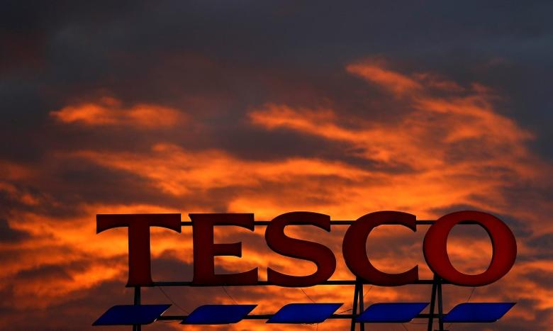 A company logo is pictured outside a Tesco  supermarket in Altrincham northern England, April 16, 2016. REUTERS/Phil Noble/File Photo
