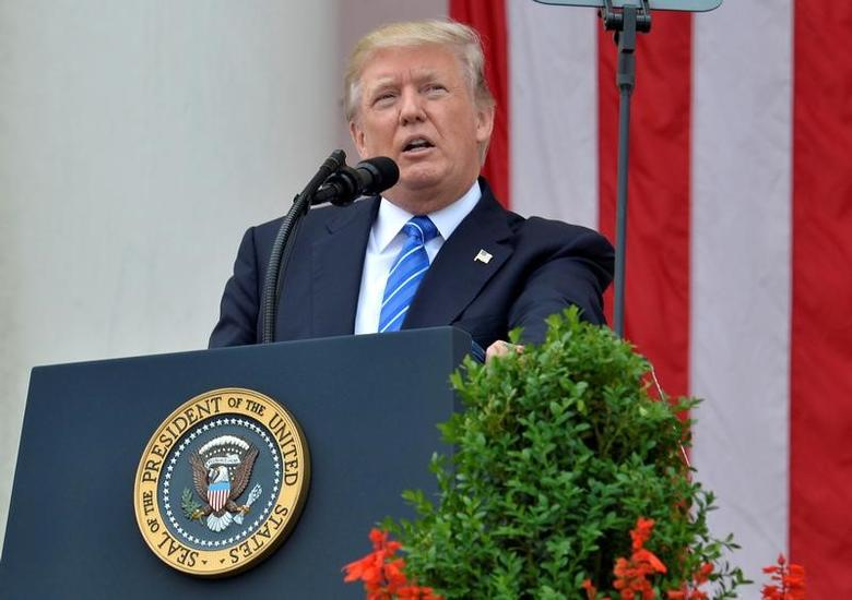 U.S. President Donald Trump makes remarks at the Amphitheater after laying a wreath at the Tomb of the Unknown Soldier at Arlington National Cemetery as part of Memorial Day observance, Arlington, Virginia, U.S., May 29, 2017. REUTERS/Mike Theiler