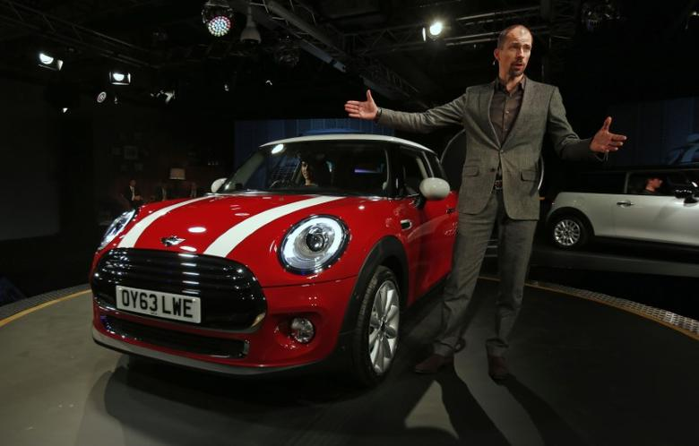 Chief of Design for the Mini division of BMW, Anders Warming introduces the new Mini at the company's plant in Oxford, southern England November 18, 2013. REUTERS/Suzanne Plunkett