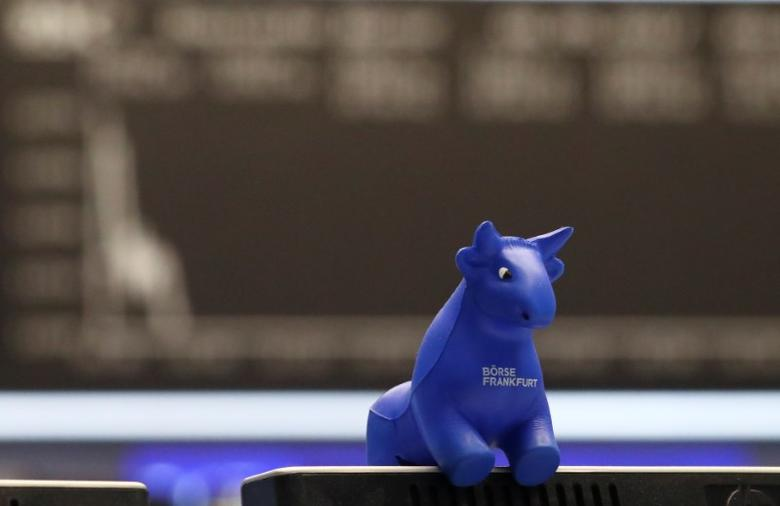 A plastic bull figurine, symbol of the Frankfurt stock exchange is pictured in front of the share price index DAX board at the stock exchange in Frankfurt, Germany, May 8, 2017. REUTERS/Kai Pfaffenbach