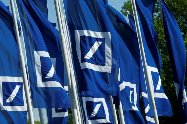 Flags with the logo of Deutsche Bank are seen at the headquarters ahead of the bank's annual general meeting in Frankfurt, Germany May 18, 2017.  REUTERS/Ralph Orlowski