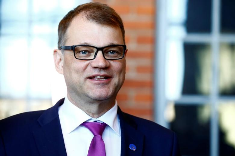 FILE PHOTO: Finland's Prime Minister Juha Sipila speaks to media after government's open session for members of public took place during the celebration of the 100th anniversary of Finnish independence in Porvoo, Finland May 4, 2017. REUTERS/Ints Kalnins