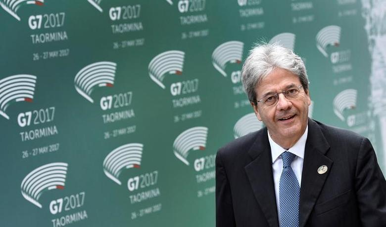 FILE PHOTO: Italian Prime Minister Paolo Gentiloni attends the G7 summit in Taormina, Sicily Italy, May 26, 2017. REUTERS/Dylan Martinez