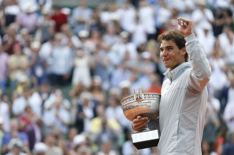 Rafael Nadal of Spain reacts as he attends the trophy ceremony after defeating Novak Djokovic of Serbia during their men's singles final match to win the French Open Tennis tournament at the Roland Garros stadium in Paris June 8, 2014.                  REUTERS/Vincent Kessler