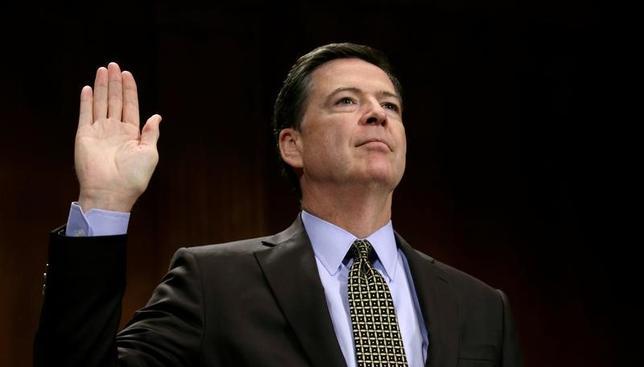 5月31日、コミー前連邦捜査局(写真)長官は議会証言で、フリン前大統領補佐官(国家安全保障担当)とロシアとの関係を巡る捜査を打ち切るよう、トランプ大統領から圧力を受けたとの報道を確認する見通しだ。CNNが関係筋の話として報じた。写真は3日撮影(2017年 ロイター/Kevin Lamarque)