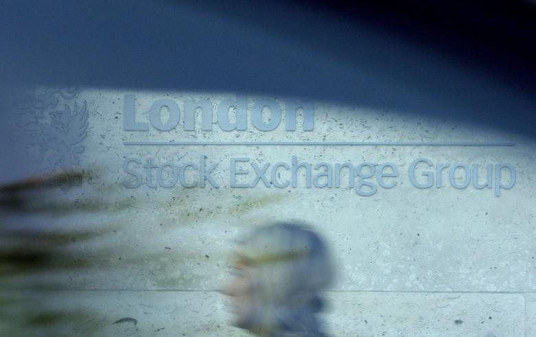 A woman is seen through a car window as she walks past the London Stock Exchange October 27, 2008.  REUTERS/Alessia Pierdomenico