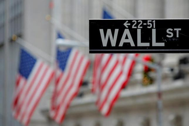 FILE PHOTO: A street sign for Wall Street is seen outside the New York Stock Exchange (NYSE) in New York City, U.S., December 28, 2016.   REUTERS/Andrew Kelly