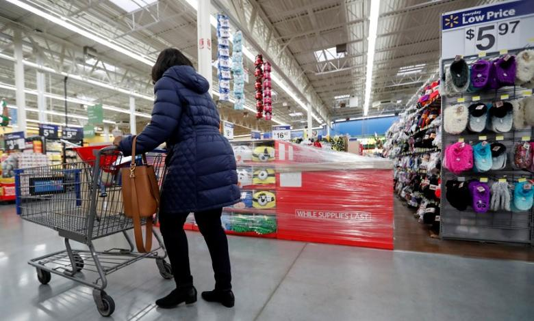 A customer pushes a shopping cart past a Black Friday display at a Walmart store in Chicago, Illinois, U.S. November 23, 2016. REUTERS/Kamil Krzaczynski