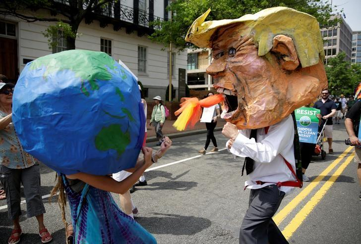 Protesters dressed as the earth and U.S. President Donald Trump pretend to fight during the Peoples Climate March near the White House in Washington, U.S., April 29, 2017.  REUTERS/Joshua Roberts