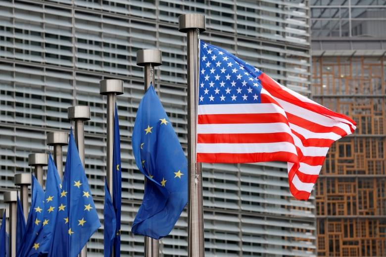 FILE PHOTO: U.S. and European Union flags are pictured during the visit of Vice President Mike Pence to the European Commission headquarters in Brussels, Belgium February 20, 2017. REUTERS/Francois Lenoir