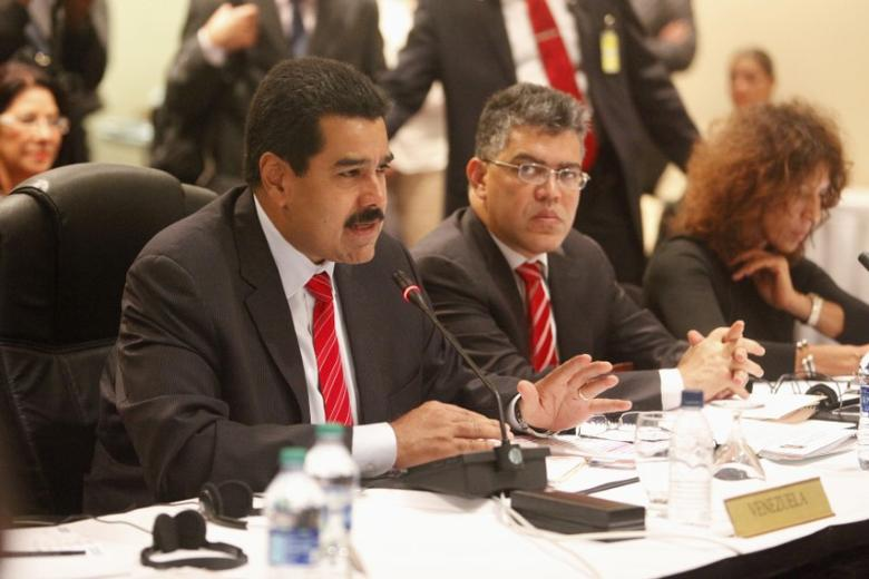 FILE PHOTO: Venezuelan President Nicholas Maduro addresses members of CARICOM at a plenary session during the 40th Heads of government meeting at the Hilton Trinidad and Conference Centre July 6, 2013. REUTERS/Andrea De Silva