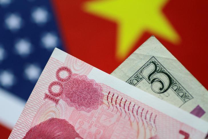 U.S. Dollar and China Yuan notes are seen in this picture illustration June 2, 2017. REUTERS/Thomas White/Illustration