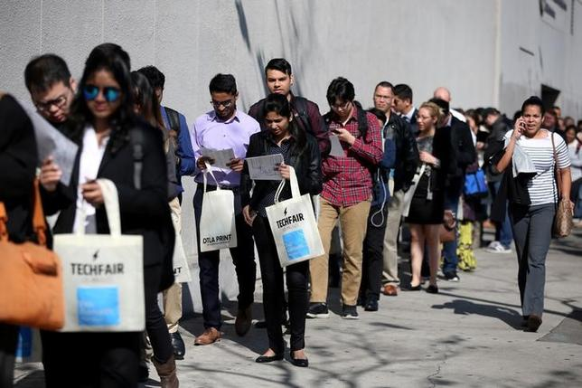FILE PHOTO - People wait in line to attend TechFair LA, a technology job fair, in Los Angeles, California, U.S. on January 26, 2017. REUTERS/Lucy Nicholson/File Photo