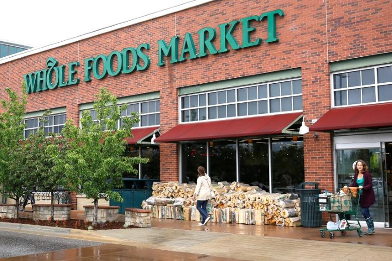 Customers leave the Whole Foods Market in Boulder, Colorado May 10, 2017.  REUTERS/Rick Wilking